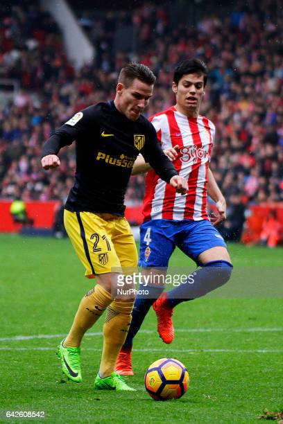 Kevin Gameiro forward of Atletico de Madrid battles for the ball with Jorge Mere defender of Sporting de Gijon during the La Liga Santander match...