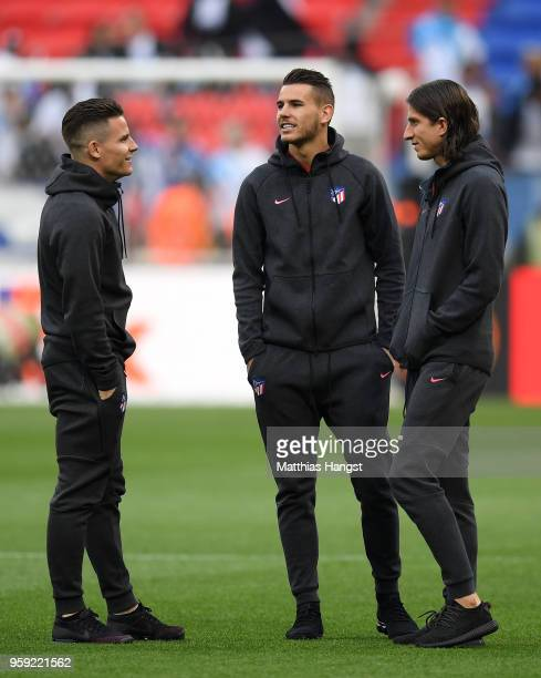 Kevin Gameiro Lucas Hernandez and Filipe Luis of Atletico Madrid speak on the pitch ahead of the UEFA Europa League Final between Olympique de...