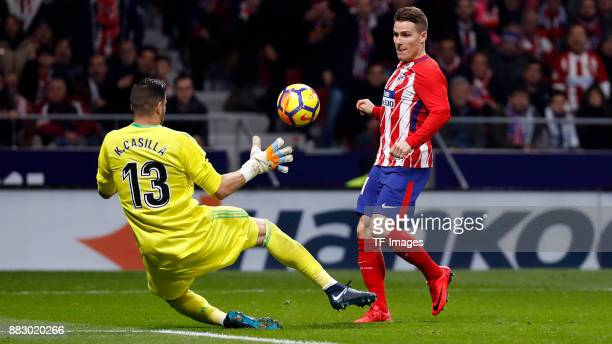 Kevin Gameiro of Atletico de Madrid and Kiko Casilla of Real Madrid battle for the ball during a match between Atletico Madrid and Real Madrid as...