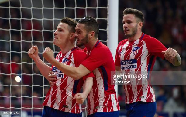 Kevin Gameiro of Atletico de Madrid celebrates Koke Resurreccion of after scoring his team's opening goal during the La Liga match between Atletico...