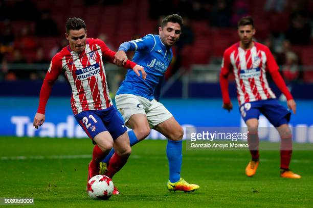 Kevin Gameiro of Atletico de Madrid competes for the ball with Ivan Agudo Martinez of Lleida Esportiu during the Copa del Rey second leg match...