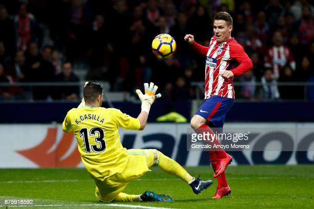 Kevin Gameiro of Atletico de Madrid competes for the ball with goalkeeper Francisco alias Kiko Casilla of Real Madrid CF during the La Liga match...
