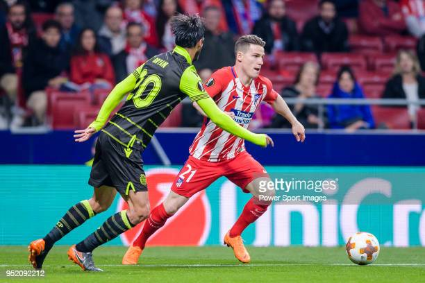 Kevin Gameiro of Atletico de Madrid fights for the ball with Bryan Ruiz of Sporting CP during the UEFA Europa League quarter final leg one match...