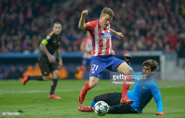 Kevin Gameiro of Atletico de Madrid hits the ball to score the second goal of his team during a match between Atletico Madrid and AS Roma as part of...
