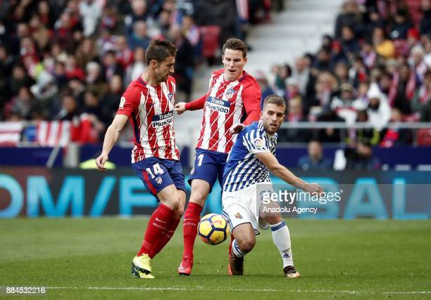 Kevin Gameiro of Atletico de Madrid in action against Kevin Rodrigues of Real Sociedad during the La Liga match between Club Atletico Madrid and Real...