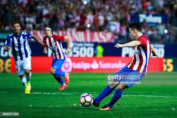 Kevin Gameiro of Atletico de Madrid scores their opening goal from a penalty shot during the La Liga match between Club Atletico de Madrid and...