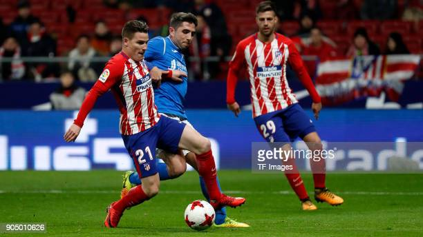 Kevin Gameiro of Atletico Madrid and a player of Lleida battle for the ball during the Copa Del Rey match between Atletico de Madrid and Lleida...