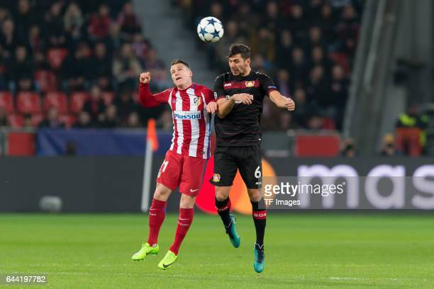 Kevin Gameiro of Atletico Madrid and Aleksandar Dragovic of Bayer Leverkusen battle for the ball during the UEFA Champions League Round of 16 first...