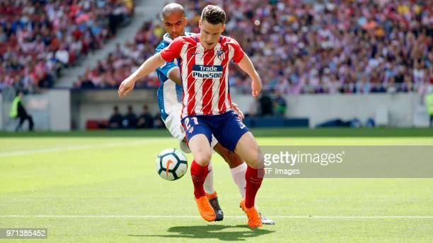 Kevin Gameiro of Atletico Madrid and Naldo of Espanyol battle for the ball during the La Liga match between Atletico Madrid and Espanyol Barcelona at...