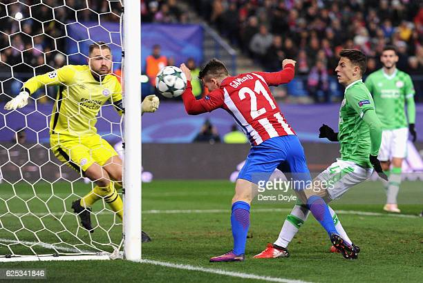Kevin Gameiro of Atletico Madrid celebrates scoring his sides first goal during the UEFA Champions League Group D match between Club Atletico de...