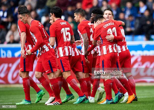 Kevin Gameiro of Atletico Madrid celebrates with his teammate Angel Correa of Atletico Madrid after scoring the opening goal during the La Liga match...