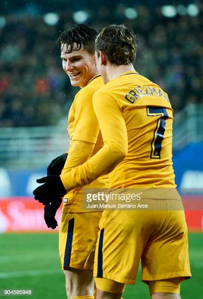 Kevin Gameiro of Atletico Madrid celebrates with his teammate Antoine Griezmann of Atletico Madrid after scoring the opening goal during the La Liga...