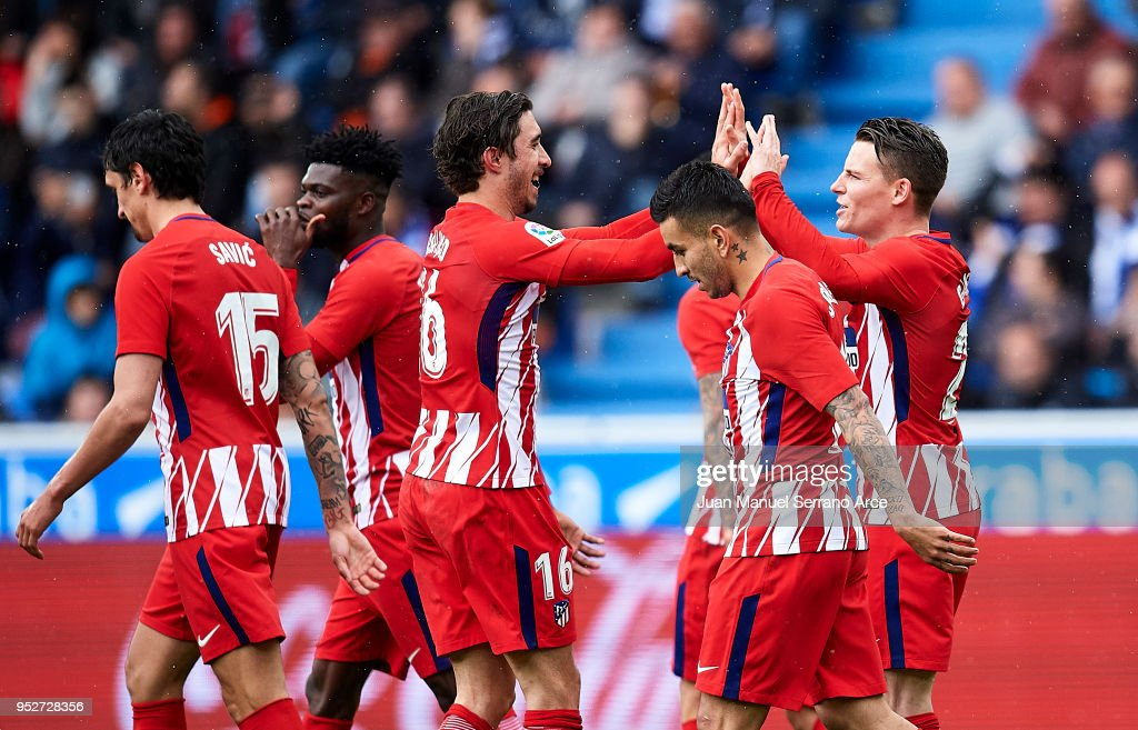 Kevin Gameiro (R) of Atletico Madrid celebrates with his teammate Sime Vrsaljko of Atletico Madrid after scoring the opening goal during the La Liga match between Deportivo Alaves and Atletico Madrid at Mendizorroza stadium on April 29, 2018 in Vitoria-Gasteiz, Spain.