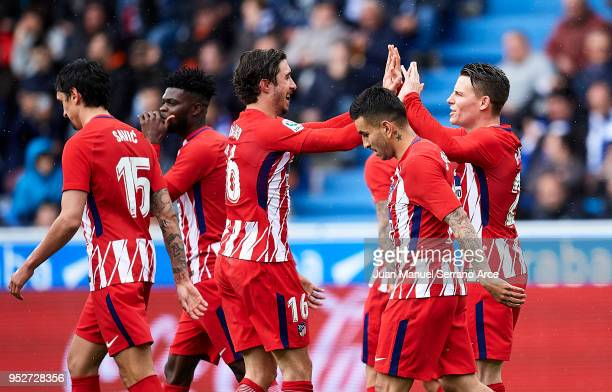 Kevin Gameiro of Atletico Madrid celebrates with his teammate Sime Vrsaljko of Atletico Madrid after scoring the opening goal during the La Liga...
