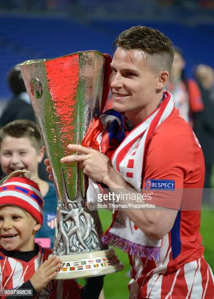 Kevin Gameiro of Atletico Madrid celebrates with the trophy after the UEFA Europa League Final between Olympique de Marseille and Club Atletico de...