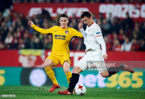 Kevin Gameiro of Atletico Madrid duels for the ball with Clement Lenglet of Sevilla FC during the Copa del Rey Quarter Final second Leg match between...