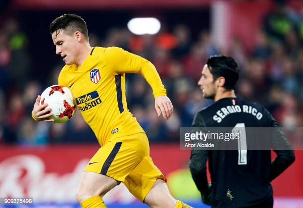 Kevin Gameiro of Atletico Madrid picks up the ball after Antoine Griezmann of Atletico Madrid scored during the Copa del Rey Quarter Final second Leg...