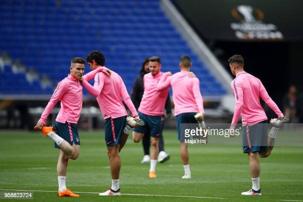 Kevin Gameiro of Atletico Madrid stretches alongside team mates during a Club Atletico de Madrid training session ahead of the the UEFA Europa League...