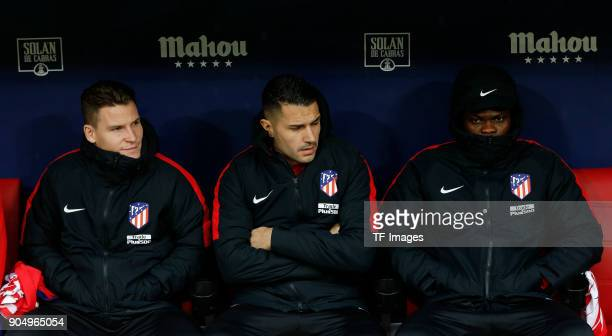 Kevin Gameiro of Atletico Madrid Vitolo of Atletico Madrid and Thomas of Atletico Madrid look on during the La Liga match between Atletico Madrid and...