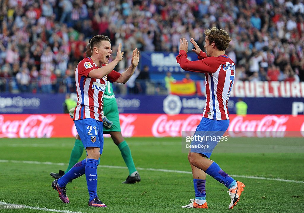 Kevin Gameiro of Club Atletico de Madrid celebrates with Antoine Greizmann after scoring his team's 3rd goal during the La Liga match between Club Atletico de Madrid and Malaga CF at estadio Vicente Calderon on October 29, 2016 in Madrid, Spain.