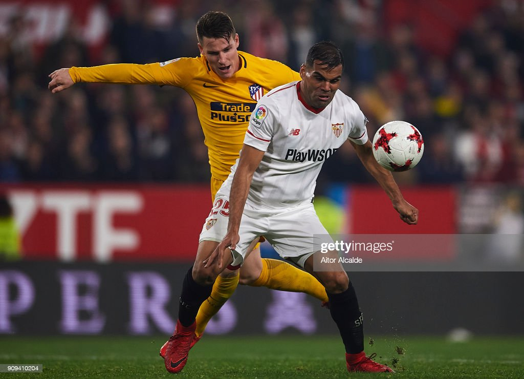 Kevin Gameiro of Club Atletico de Madrid (L) competes for the ball with Gabriel Mercado of Sevilla FC (R) during the Copa del Rey, Quarter Final, second Leg match between Sevilla FC and Atletico de Madrid at Estadio Ramon Sanchez Pizjuan on January 23, 2018 in Seville, Spain.