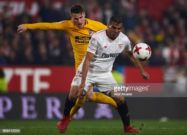 Kevin Gameiro of Club Atletico de Madrid competes for the ball with Gabriel Mercado of Sevilla FC during the Copa del Rey Quarter Final second Leg...