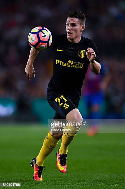 Kevin Gameiro of Club Atletico de Madrid runs with the ball during the La Liga match between FC Barcelona and Club Atletico de Madrid at the Camp Nou...