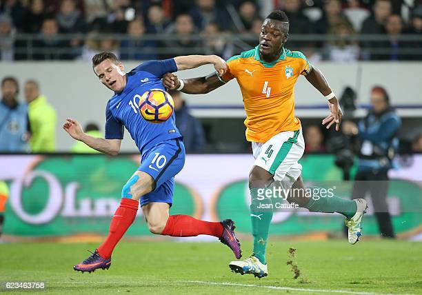 Kevin Gameiro of France and Lamine Kone of Ivory Coast in action during the international friendly match between France and Ivory Coast at Stade...