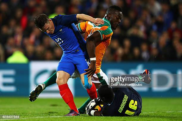 Kevin Gameiro of France battles for the ball with i4 and Goalkeeper Sylvain Gbohouo of The Ivory Coast during the International Friendly match...