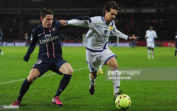 Kevin Gameiro of Paris SaintGermain battles with Fethi Harek of SC Bastia during the Ligue 1 match between Paris SaintGermain FC and SC Bastia at...