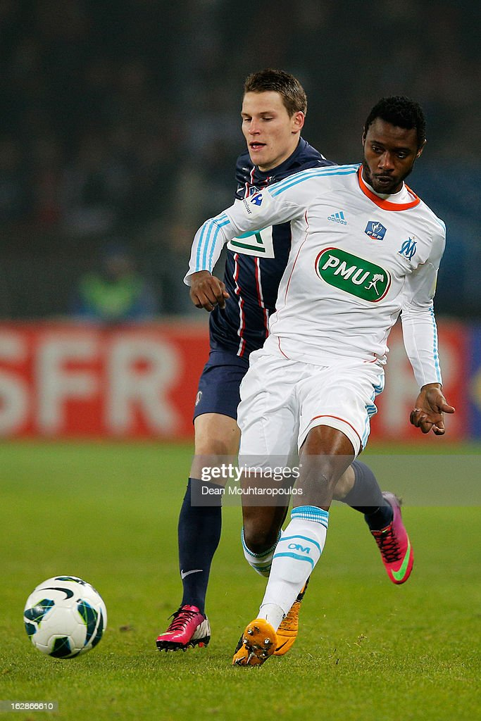Kevin Gameiro of PSG is beaten to the ball from Nicolas N'Koulou of Marseille during the French Cup match between Paris Saint-Germain FC and Marseille Olympic OM at Parc des Princes on February 27, 2013 in Paris, France.