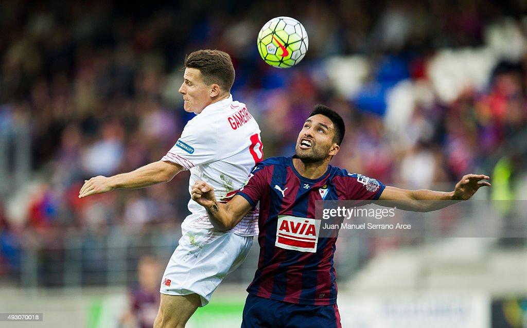 Kevin Gameiro of Sevilla FC duels for the ball with Mauro Javier Dos Santos of SD Eibar during the La Liga match between SD Eibar and Sevilla FC at Ipurua Municipal Stadium on October 17, 2015 in Eibar, Spain.