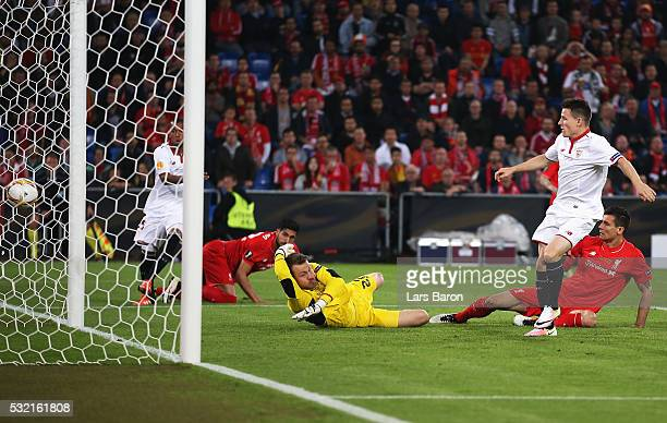 Kevin Gameiro of Sevilla scores his team's first goal past Simon Mignolet of Liverpool during the UEFA Europa League Final match between Liverpool...
