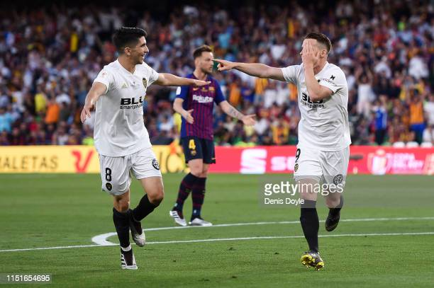Kevin Gameiro of Valencia CF celebrates with his team mate Carlos Soler after scoring his team's first goal during the Spanish Copa del Rey match...