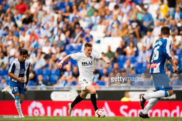 Kevin Gameiro of Valencia CF conducts the ball during the La Liga match between RCD Espanyol and Valencia CF at RCDE Stadium on August 26 2018 in...