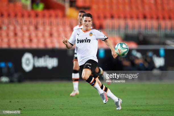 Kevin Gameiro of Valencia CF runs for the ball during the Liga match between Valencia CF and RCD Espanyol at Estadio Mestalla on July 16 2020 in...