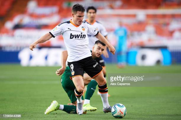 Kevin Gameiro of Valencia CF runs with the ball during the Liga match between Valencia CF and RCD Espanyol at Estadio Mestalla on July 16 2020 in...