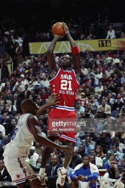 Kevin Garnett of the Western Conference AllStars puts a shot up over Antoine Walker of the Eastern Conference AllStars during the 2003 NBA AllStar...
