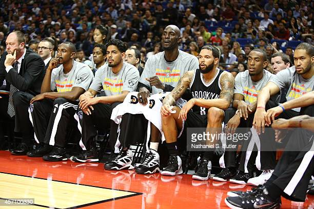 Kevin Garnett and Deron Williams of the Brooklyn Nets looks on against the Sacramento Kings during the 2014 NBA Global Games at the MercedesBenz...
