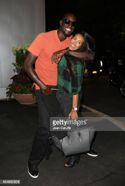 Kevin Garnett and his wife Brandi Garnett attend the match between Roger Federer of Switzerland and Gael Monfils of France during Day 11 of the 2014...