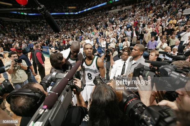 Kevin Garnett and Latrell Sprewell of the Minnesota Timberwolves give a post game interview with Cheryl Miller of TNT as they are surrounded by fans...