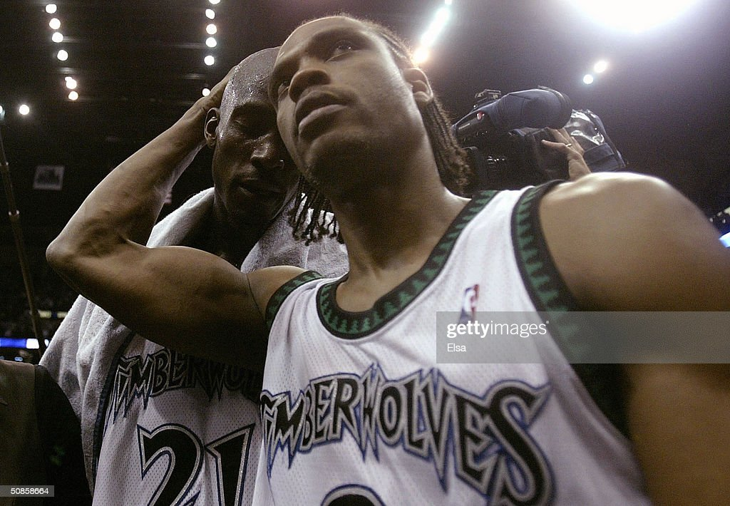 Kevin Garnett #21 and Latrell Sprewell #8 of the Minnesota Timberwolves celebrate their win over the Sacramento Kings in game seven of the NBA Western Conference Semifinals on May 19, 2004 at the Target Center in Minneapolis, Minnesota. The Timberwolves defeated the Kings 83-80 to advance to the Western Conference Finals against the Los Angeles Lakers.