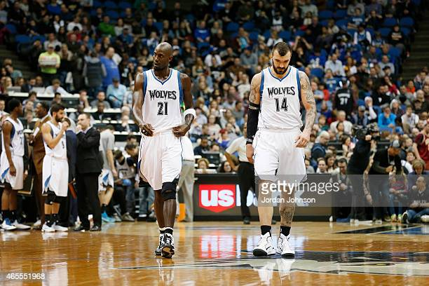 Kevin Garnett and Nikola Pekovic of the Minnesota Timberwolves during the game against the Portland Trail Blazers on March 7 2015 at Target Center in...