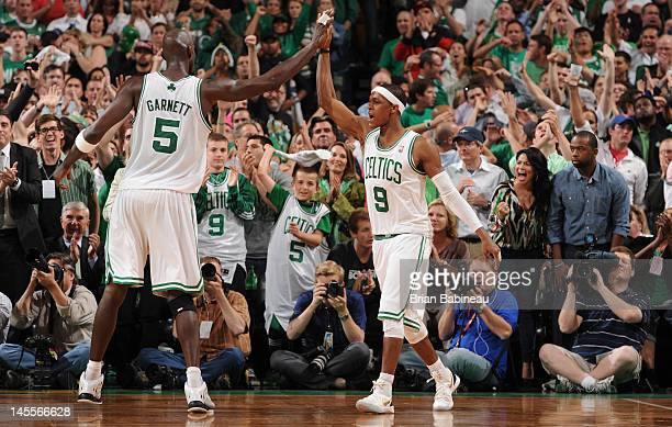 Kevin Garnett and Rajon Rondo of the Boston Celtics high five after a play against the Miami Heat in Game Three of the Eastern Conference Finals...