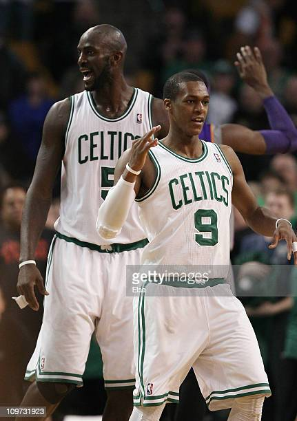 Kevin Garnett and Rajon Rondo of the Boston Celtics signal that Rondo has three shots after drew the foul in the final seconds of the game against...