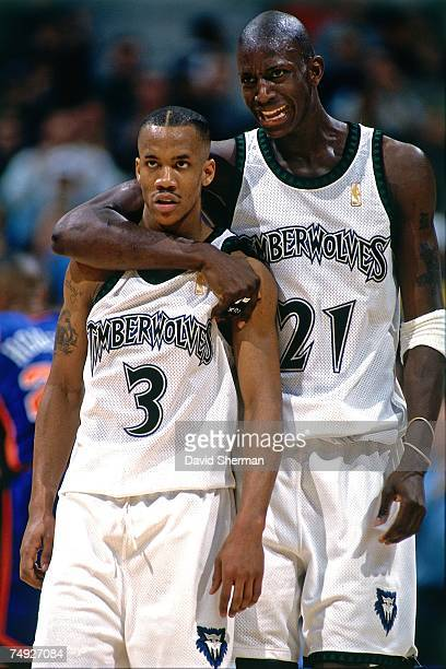 Kevin Garnett and Stephon Marbury of the Minnesota Timberwolves embrace during a 1997 NBA game at the Target Center in Minneapolis Minnesota NOTE TO...