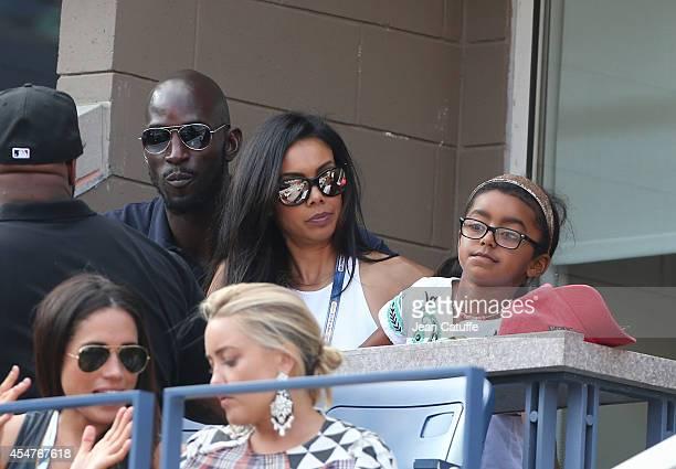 Kevin Garnett his wife Brandi Garnett and their daughter Capri Garnett attend the women's semi finals during Day 12 of the 2014 US Open at USTA...