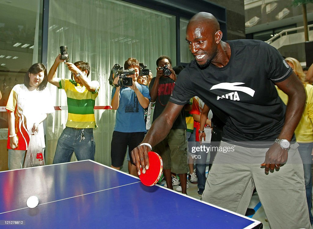 Kevin Garnett of Boston Celtics plays table tennis during ANTA commercial event on August 17, 2011 in Wuhan, Hubei Province of China.