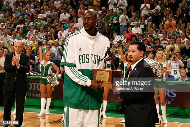 Kevin Garnett of the Boston Celtics accepts his award for NBA defensive player of the year before Game Two of the Eastern Conference Quarterfinals...