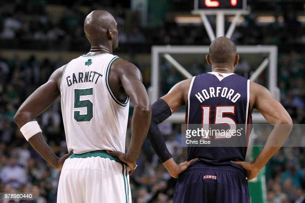 Kevin Garnett of the Boston Celtics and Al Horford of the Atlanta Hawks look on in Game Six of the Eastern Conference Quarterfinals during the 2012...